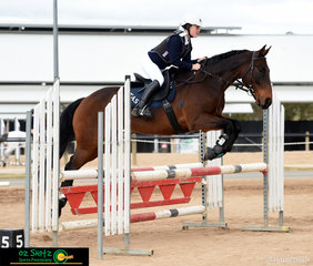 Charlie Ward from The Armidale School and her trusty horse Pickles leap powerfully over the 90cm jump.