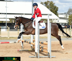 Enjoying a smooth ride around the 60cm Show Jumping course was Liam Mackenzie-Smith and his horse Barrelyn Warlord.