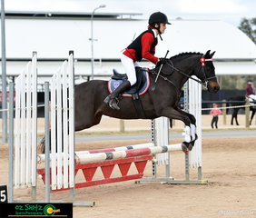 Clearing the oxer with ease in the Primary 65cm Show Jumping course was Angelina Thompson from Arndell Anglican College and her horse Cherrywood Solo.