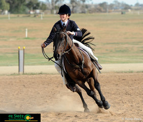 Coming out of their second turn in their workout, Brie Aitken and Denmark Webkey Two compete in the Working phase of the Working Horse Challenge held on the last day of the Interschool Horse Extravaganza.