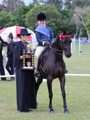 Champion Junior Rider Amelia Waller with judge Alexia Fraser