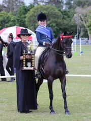 Champion Junior Rider Amelia Waller with judge Alexia Fraser