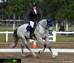 Representing Beaudesert State High School is  Sophie Peach amd her powerful 8 year old horse LE Royal Roxanne in their first preliminary dressage test of the day.