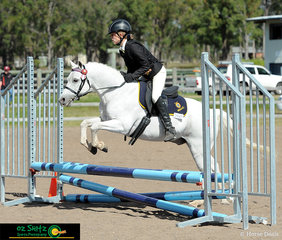 Flying over jumps on day 2 of the QLD Interschool State Championships is Kayla Moore and her mount Blue Denim Victory.