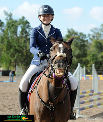 Staying true to his character, Undiees gives the camera a big smile with rider Sarah Coggan during their presentation of the Secondary 70cm Two Phase on the first of three days of Show Jumping.