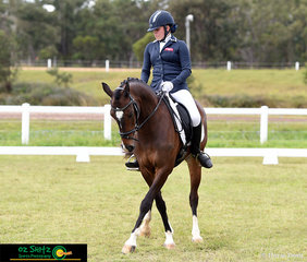 Conducting a beautiful Walk Pirouette during her Elementary test 3C was Darcy Flanagan riding for St Andrews Catholic College on Benjaylin Flirtatious at the Queensland Interschool State Championships.