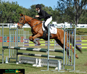 Clearing jumps with ease was Maya Jackson riding her mare Miss Kia who continued on to the jump off and recieved a placing..
