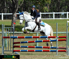 Riding for St Columbans College was Alise Meakins on Emmaville Spice flying through the secondary 1m show jumping in Maryborough.