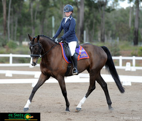 Riding a beautiful circle at B was Kate Johnstone riding G Force in her Senior Preliminary dressage test on the first day of the QLD Interschool State Championships.