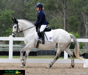 Representing St Johns Catholic School is Madison Thomas and her grey mount Redgum Allegra in the Senior Preliminary dressage.