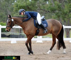 Big hugs from Caitlin Ward to Croyden Park Clickety Clack after riding a good dressage test at the QLD Interschool State Championships.