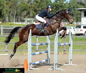 Lyla Sampson and Cassilis Park Figaro clearing jumps in the 1.10m Show Jumping at QLD Interschool State Championships.