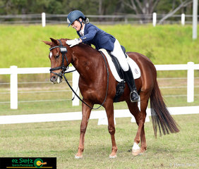 """Sir Akers Crikey receives a """"good boy!""""  pat from very happy rider Chelsea Gatti after their test in the Elementary Dressage.."""