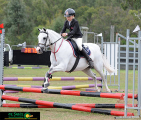 Placing 2nd in the Primary 50cm AM5 Class was Morgan Lyall representing Genesis Christian College, in Year 6, riding her little grey pony Elray All Saint.