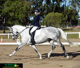 Jingle Jangle shows how it's done in the Meduim Dressage 4B with rider Piper Kilgore performing a outstanding extended trot across the diagional.