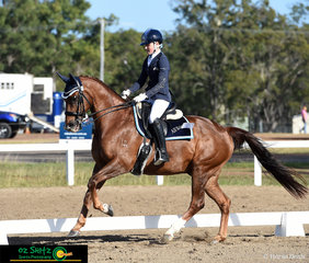 The Judges of the Meduim Dressage were graced with the presence of Charlotte Adamson and her steed, Jazzaround. The pair cantered down the arena with their All Saints saddle blanket on display for all.