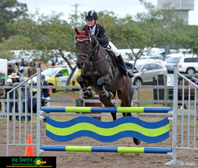 The brightly coloured skinny fence gave Foxhill Kaypers no trouble as he piloted Maddison Herd over the final jump in the 100cm Secondary AM5 round.