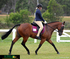 Showing great extension during the Rider phase of the Senior Show Horse was To Be Advised with rider Olivia Farrell who represents St John Fisher College in Bracken Ridge.