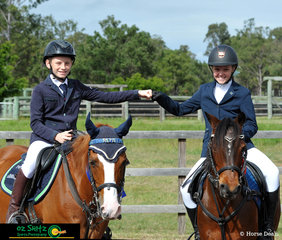 Very good friends Zac Goodall on Aerowhon Park Remington (left) and Isabella Forsythe on Ethereal Duchesse De Bloom (right) enjoy their friendly rivalry during the Secondary 70cm Show Jumping rounds.