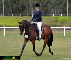 Effortlessly trotting across the arena was Lexie Armstrong and Grand Entrance in their Secondary Show Horse Qualifier at the Queensland Interschool State Championships in Maryborough.