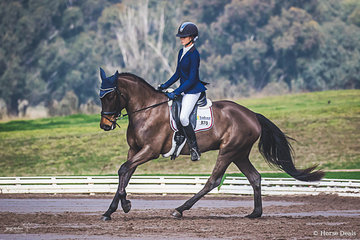 Monet Stevenson (NSW) and Dubendorf Santa Hit executing their Preliminary 1B test scoring a solid 67.143 to finish 6th