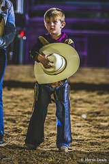 Without hesitation hat off for the national anthem.  Young junior cowboy Weston Hilditch from Dimbulah called to the arena for team presentation in the state of origin challenge. A proud moment for him and his family