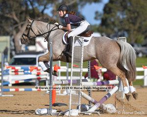"Jorga Kirsopp-Cole in the Pony Club C Grade representing Mount Duneed Pony Club riding ""Champagne Lola"", winner of the C Grade Championship"