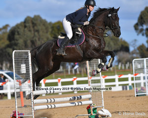 """Emma Brooks easily clears the jump in the Open C Grade riding """"""""Twiggy"""""""