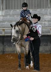 TJ Fleming riding Tally S Imyourhero with Lisa Fleming.