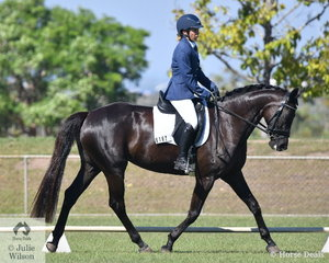 Jacqueline Gould rode her good moving, Why Waltz Furst Lady Love in the Preliminary 1C.