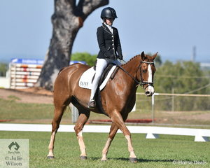 Grace McDonald riding Hootchy Kootchy Rush took third place in the Pony 1B.