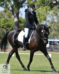 Teresa Cummings riding Tailor Made Future competed in the Preliminary 1B.