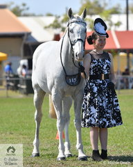 Emily Hubble looking elegant.with Optimum Prime in the large class of Fashions on the Field.