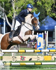 Rosco Robertson from Kununurra WA on Crayola jumped a clear round in the 80cm One Round Stakes.