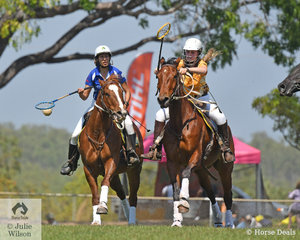 Katherine Brint and Tucker for the Howard Springs team head off her opposition in the Exhibition Polocrosse match.