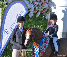 "Mia Skinner led ""Armanii Park Robin Hood"" to win Champion Show Hunter Leading Rein Pony - ridden by Jett Skinner."