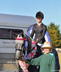 """Toni Ambrose with her Small Saddle Horse Champion """"Set In Diamonds"""" ridden by Courtney Larard. This win had them in the draw for the brand new Regency Float they're standing in front of - they won!"""