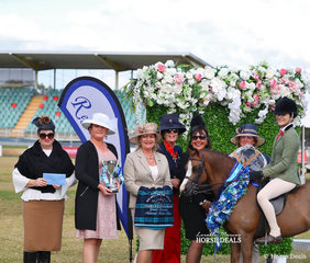 """Grand Champion Exhibit of the Show went to the Champion Small Show Hunter Pony """"Armanii Park Robin Hood"""", ridden by Mia Skinner for owner Kim Glover. Pictured with judges Belinda Scanlon, Melissa Harding, Bronwyn Parker, Mardi Mangan, Rachel Douglas and Jo Maunder."""