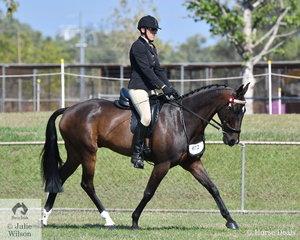 Lorraine Scott rode her Standardbred, Royal Pride to win the Novice Hack class.