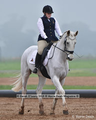 "Liz Jenyns riding ""Tulara Don Moon"" representing Riddells Creek in the Level 4"