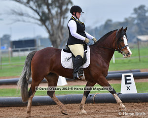 """Melody Pappin riding """"Polly Nintu Whispers"""" in the Level 3 representing Echuca"""
