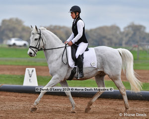 """Sue Johnston riding """"Cintra Grey Song"""" representing Western Port ARC in the Level 3"""