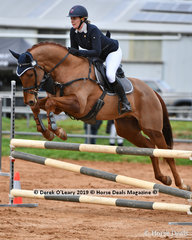 "Chelsea Priestley in the Open Grade 2 Show Jumping riding ""Rossatin"""