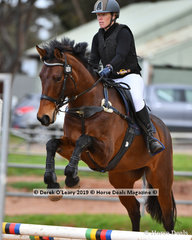 "Vanessa Bourk in the Open Grade 3 Show Jumping riding ""Ibeon Shilo"""