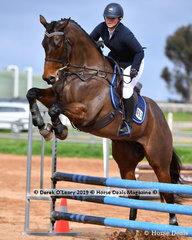 "Paige Cartwright in the Open Grade 3 Show Jumping riding ""Warrior King"""