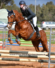 "Laura King in the Open Grade 3 riding ""Captivate Me"""