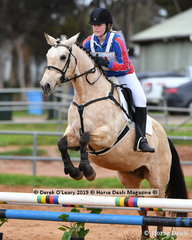 """Mikayla Bartlett in the Pony Club Grade 4 Show Jumping riding """"Happy as Larry"""" representing Melton & District Pony Club"""