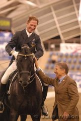 Heath Ryan rode Dr Margaret Evan's imported Rubenstein stallion, 'Regardez Moi' to take second place in the Koffels Solicitors and Barristers Intermediate II with 65.885%. Seen here with President of the Ground Jury, Wolker Moritz from Germany.