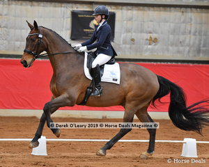 "Shannon Stone placed 4th in the Advanced 5A riding ""Danson Donnerking"" with a total score of 64.474%"