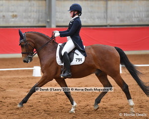 "Winners of the Advanced Championship, Amy Bachmann and ""Silverdene Pharaoh"" with 68 total points in the championship, and 66.149% in the 5B test"